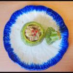 Quelle sere d'estate: zucchine tonde ripiene di risotto alle olive e pepe rosa.